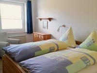 Schlafzimmer Ferienwohnung Wattwurm